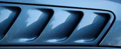 Air intakes. Car detail, like the gills of a shark royalty free stock image