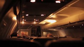 Air Jet airplane interior view at night. Woman stock video footage