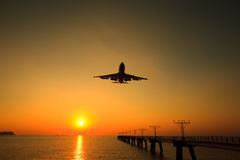 Air jet is landing with the Sunset Stock Images