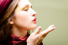 Air kiss closeup of girl in dotted bow tie on Royalty Free Stock Photography