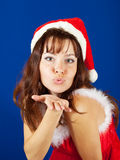 Air-kissing   girl in christmas costume Stock Image