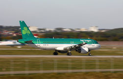 Air Lingus Airbus A-320. Air Lingus airline Airbus A-320 taking off with panning photo royalty free stock images