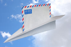 Air Mail. A paper airplane carrying an airmail. Clipping path included royalty free stock photo