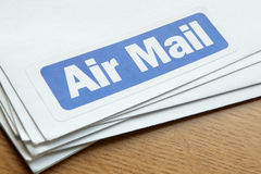 Air mail documents for despatch. On wooden desk Royalty Free Stock Photo