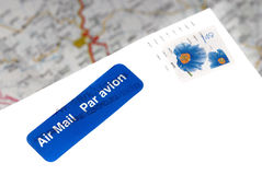 Air Mail envelope over of map Royalty Free Stock Photo