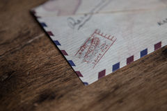 Air mail envelope on wood background Stock Images