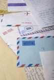 Air Mail envelopes with old handwritten letters. Air mai envelopes surrounded by old letters, postcards and white envelopes stock photo