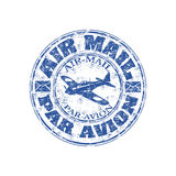 Air mail grunge rubber stamp. Blue grunge rubber stamp with plane shape and the text air mail, par avion written inside the stamp Stock Photography