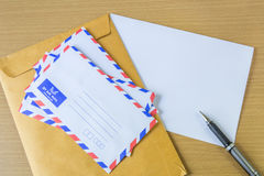 Air mail letter and pen. Royalty Free Stock Photos