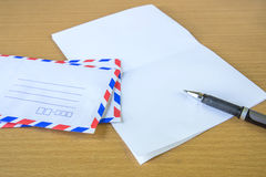 Air mail letter and pen. Stock Photos