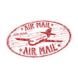 Air mail rubber stamp. Red grunge rubber stamp with plane symbol and the text air mail written inside the stamp Royalty Free Stock Image