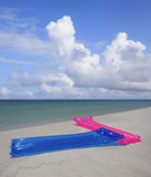 Air Mattresses on Florida Beach Stock Photography