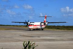 Air Mauritius ATR 72 plane on runway. Image of an Air Mauritius ATR 72 plane taxiing on runway, shortly after landing on Rodrigues Island, Mauritius. Editorial Royalty Free Stock Photo