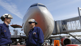 Air mechanics and airliner Stock Photo