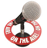 On the Air Microphone Words Live Interview Report. On the Air words in a ring around a microphone to illustrate a live report or interview on radio or podcast Royalty Free Stock Images
