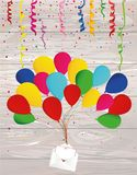 Air multicolored balloons raise an envelope or letter with heart. S. Colorful confetti. Valentine`s Day. I love. Vector on wooden background. Greeting card or Stock Photo