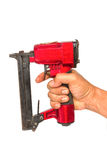 Air Nailer or  Nail gun. Carpenter tools Royalty Free Stock Photo