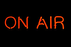 On Air neon sign. Red neon sign of the word 'On Air' on a black background Royalty Free Stock Images