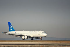 Air New Zealand 737 on runway. Air New Zealand Boeing 737 plane on the runway Stock Photo