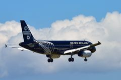 Air New Zealand Airbus A320 in All Blacks livery landing at Auckland International Airport. AUCKLAND, NEW ZEALAND - DECEMBER 17: Air New Zealand Airbus A320 in Royalty Free Stock Photo