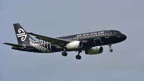 Air New Zealand Airbus A320 in All Blacks livery landing at Auckland International Airport Stock Photography