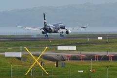 Air New Zealand Airbus A320 in All Blacks livery landing at Auckland International Airport Royalty Free Stock Photo