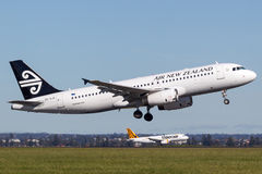 Air New Zealand Airbus A320 taking off from Sydney Airport. Stock Images
