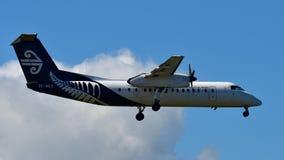 Air New Zealand ATR-72 domestic turboprop aircraft landing at Auckland International Airport. AUCKLAND, NEW ZEALAND - DECEMBER 17: Air New Zealand ATR-72 Royalty Free Stock Photo