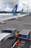 Air New Zealand Cargo Handling, Auckland Airport. Auckland, New Zealand, 02 December 2011. Cargo being unloaded in flight containers from an Air New Zealand stock images