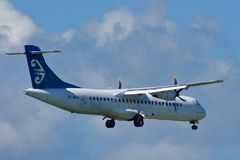 Air New Zealand Link ATR-72 regional turboprop aircraft landing at Auckland International Airport. AUCKLAND, NEW ZEALAND - DECEMBER 17: Air New Zealand Link ATR Royalty Free Stock Images