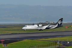 Air New Zealand Link ATR 72-500 turboprop aircraft taxiing at Auckland International Airport. AUCKLAND, NEW ZEALAND - JULY 10: Air New Zealand Link ATR 72-500 Stock Photos