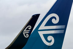 Air New Zealand logo on jet tail and wing. Air New Zealand Koru design logo on tail and wingtip of jet Stock Photo
