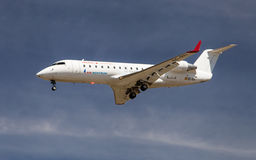 Air Nostrum Canadair CL-600 Regional Jet. An Air Nostrum Canadair CL-600 Regional Jet approaching to El Prat Airport in Barcelona, Spain royalty free stock photo
