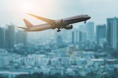 Air plane on city. Air passenger plane on city background Stock Photo
