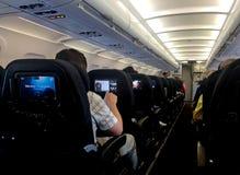 Air passengers watching media in aeroplane Royalty Free Stock Photo