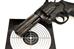 Air pistol revolver and target isolated Royalty Free Stock Images