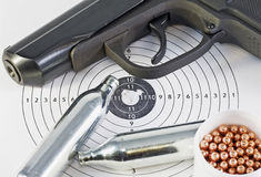Air pistol and spare parts for weapons Royalty Free Stock Photography