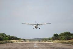 Air plane above runway royalty free stock photo