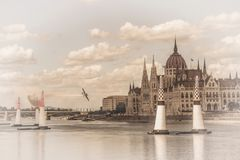 Air Plane on Budapest parliament background. Hungary. Toned background.  royalty free stock photos