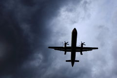Air Plane Evading Storm Stock Photography