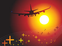 Air plane flying towards sunse Stock Photos