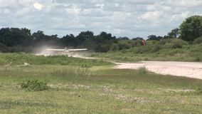 Air plane in Kenya Botswana savannah Africa stock video footage
