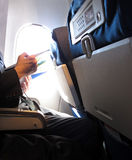 Air Plane Reading Royalty Free Stock Image