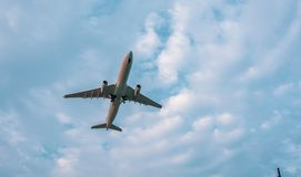 Airplane in sky low angle view with room for copy space Royalty Free Stock Image