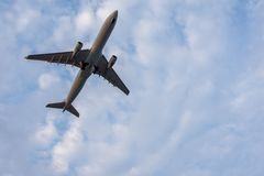 Airplane in sky low angle view with room for copy space Stock Image