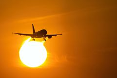 Air plane in sunset  Stock Images