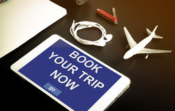 Air plane ticket online booking website on tablet. Stock Photo