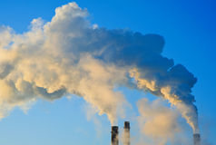Air pollution. Pollution smoke coming out from chimney of factory Royalty Free Stock Photo