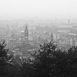 Air pollution. Black and white shot of foggy town view from the hills Royalty Free Stock Photos