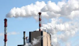 Air pollution. Paper mill smoke stakes giving off pollution Stock Images